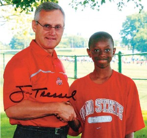A young Eli Apple with Coach Tressel