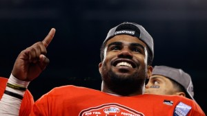 INDIANAPOLIS, IN - DECEMBER 06: Ezekiel Elliott #15 of the Ohio State Buckeyes celebrates after his team defeated the Wisconsin Badgers 59-0 in the Big Ten Championship at Lucas Oil Stadium on December 6, 2014 in Indianapolis, Indiana. (Photo by Joe Robbins/Getty Images)