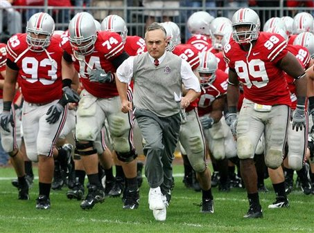 Ohio State football coach Jim Tressel, center, leads his team on the field during the second half against Penn State, Saturday, Sept 23, 2006, in Columbus, Ohio. (AP Photo/Terry Gilliam)