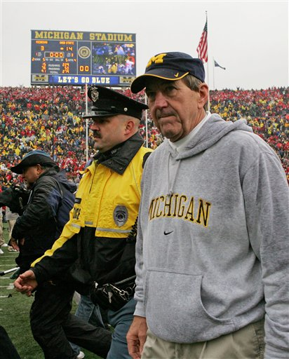 Michigan head coach Lloyd Carr walks off the Michigan Stadium field after a college football game with Ohio State, Saturday, Nov. 17, 2007, in Ann Arbor, Mich. Ohio State won 14-3. (AP Photo/Tony Ding)